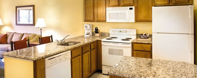 Full Kitchen with Granite Counters in the Condo at the Wyndham Smoky Mountains wide