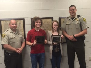 Pictured L-R: SRO Matt McPeak, Mt. Juliet HS Graduate Arron Gunn and Rachel Fullerton, SRO Lt. Scott Moore