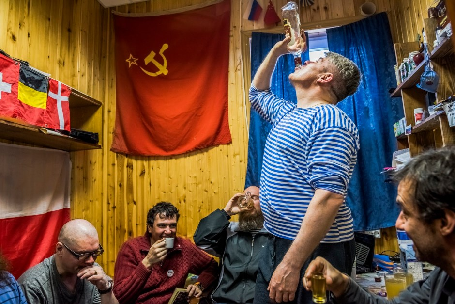 "7. ANTARCTICA - NOVEMBER 28, 2015: The winter expedition crew of Russian research team and (R) Chilean scientist Dr Ernesto Molina, drink ""Samagon"" a home-made vodka, as they sit in a bedroom of  the Bellingshausen Antarctica base on the 28th of November, 2015 near Villa Las Estrellas, in the Fildes Peninsula on King George Island, Antarctica. More than a century has passed since explorers raced to plant their flags at the bottom of the world. But today, an array of countries are rushing to assert greater influence in Antarctica. Russia built the continent's first Orthodox church, pictured here, on a glacier-filled island with fjords and elephant seals. Less than an hour away by snowmobile, Chinese labourers have updated the Great Wall Station, a linchpin in China's plan to operate 5 bases on Antarctica. And India's futuristic new Bharathi base resembles a spaceship. The continent is supposed to be protected as a scientific preserve for decades to come, but many are looking toward the day those protective treaties expire — and exploring the strategic and commercial opportunities that exist right now."