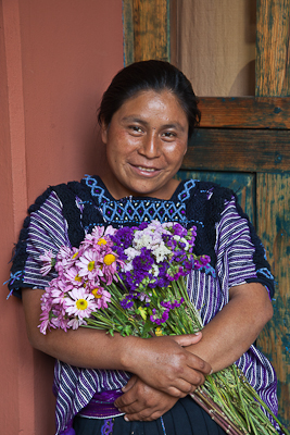 Indigenous woman with flowers, Mexico