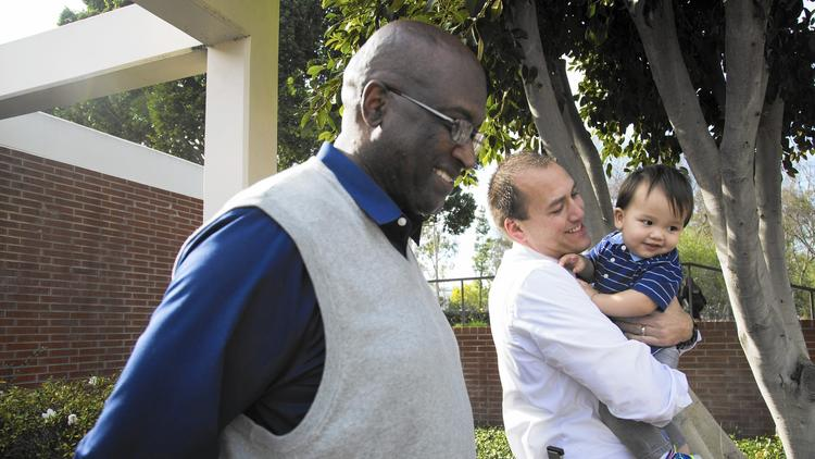 Emmitt Clark, left, Christopher Schivley and Schivley's son, Emmitt. Christoher Schivley was poor, fatherless and desperately seeking guidance when he took a career education class as a freshman at Cal State Long Beach. (Katie Falkenberg / Los Angeles Times)