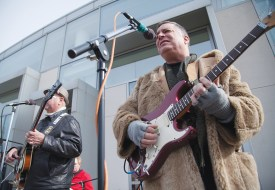 MARY Masurat / The Journal Jack Miller and Doug Carson of tribute band Abbey Road Warriors play on the 4th floor patio of the Emerson Library on Thursday, Jan. 30