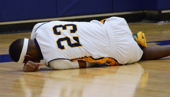 JORDAN PALMER/ The Journal Ahmad Smith falls to the floor in pain after he suffered a sprained ankle in Webster's win over Fontbonne on Jan. 17. He is expected to miss at least a week.