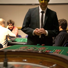 Senior finance major Jason Riss goes for the winnings at the roulette table.  BRIAN VERBARG/The Journal