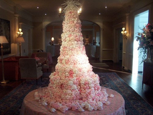 Pink and white rose covered wedding cake