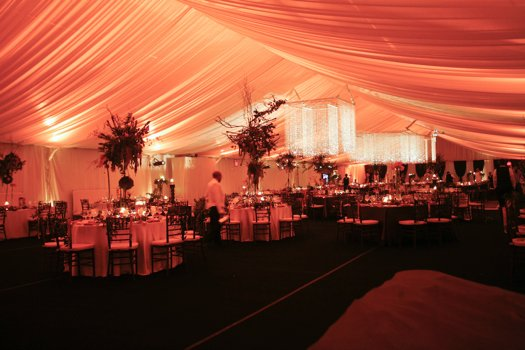 Dramatic tent decor for wedding reception