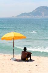 Man sitting under beach umbrella compressed1 197x300 To the Graduates of 2012