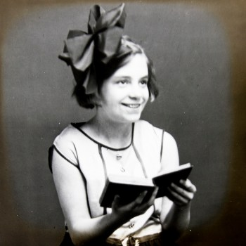 Young 1920s girl with a big bow in her hair