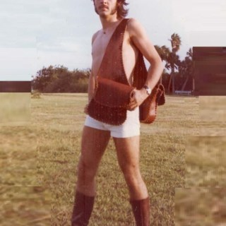 1970s mens fashion: short white shorts and leather headband