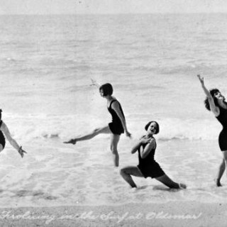 1920s girls playing in the surf