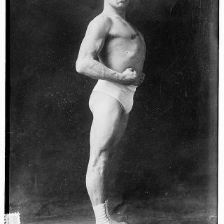 Vintage circus: strong men and contortionists