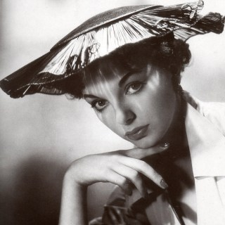 Young Joan Collins with a pancake on her head