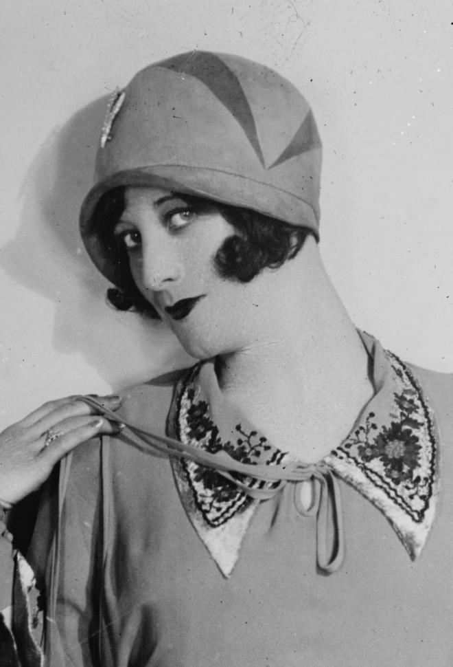 Joan Crawford wearing a cloche hat, 1920s