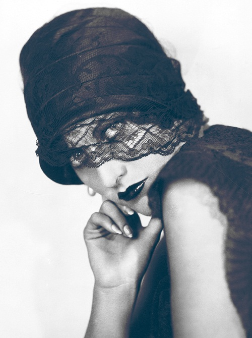 Joan Crawford looking veiled and edgy, 1920s