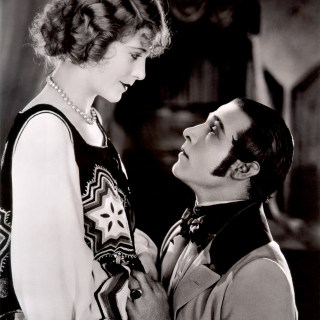 1920s movie stars Vilma Bánky & Rudolph Valentino looking passionate