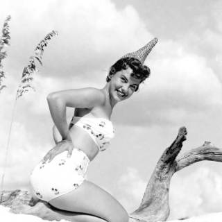 A cherry-print 1950s bikini (and a very strange hat)