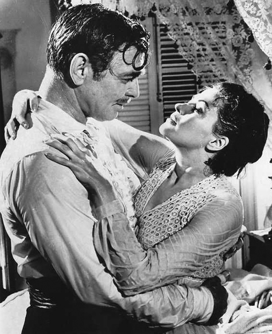 Publicity photo of Clark Gable and Yvonne de Carlo in Band of Angels. 1957