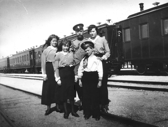 Nicholas II with his children on the train station Alma (nowadays Pochtovoe) in Crimea. In the background is the Imperial train.