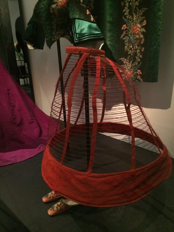 A cage crinoline from 1960-1965. Steel spring frame covered with red wool and linen