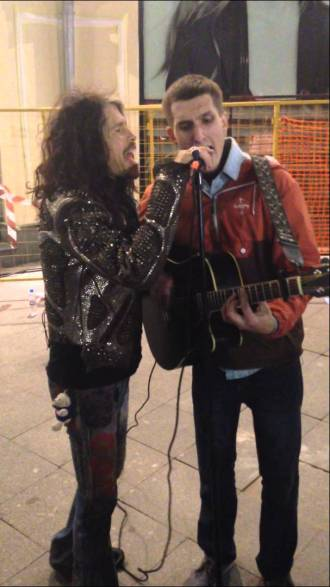 Aerosmith's Steven Tyler Singing with a Street Performer in Moscow