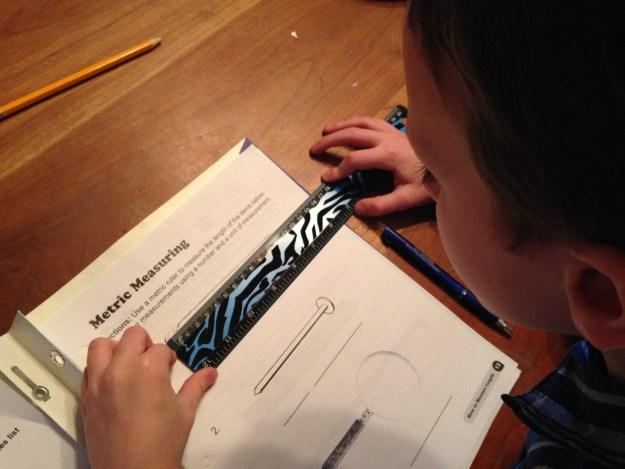 Using a ruler to measure worksheet.