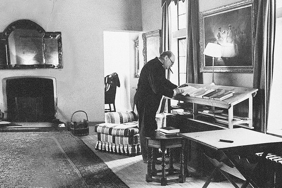 Churchill at his standing desk.