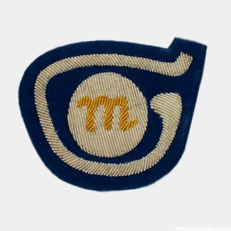 M logo silver Bullion Embroidered on Dark Blue Felt