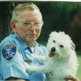 Don Carney, Coronado's former Animal Care Officer, with Sausage