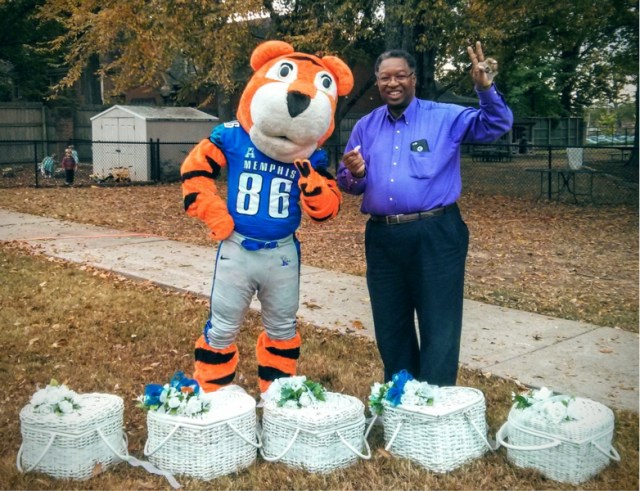 Dr. Moore with Pouncer, the University of Memphis Tigers mascot, before release of the 24 Peace Doves from their baskets, during 2015 Peace Day at the Lipman School. Photo courtesy Sandra Brown Turner.