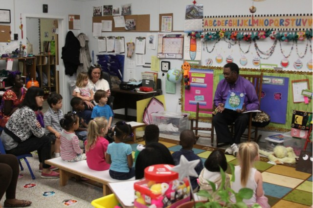 """Dr. Moore reading and singing """"Let There Be Peace on Earth"""" with 3-year-old friends at the Lipman School in Memphis on 2015 Peace Day. Photo courtesy Sandra Brown Turner."""