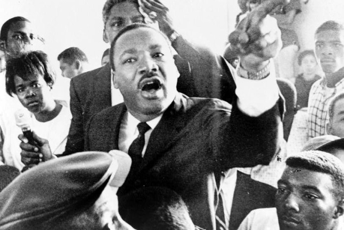 Dr. Martin Luther King, Jr. addresses group of Watts residents following the summer riots of 1965