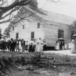 African American men, women, and children outside of church