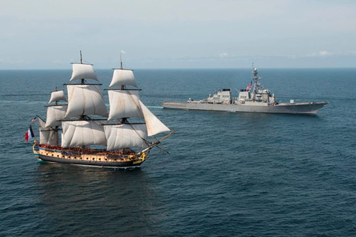 USS Mitscher and the French tall ship replica the Hermione approach Chesapeake Bay