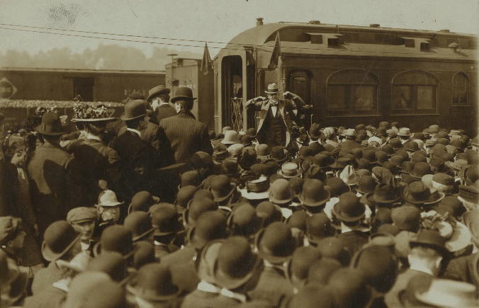 Eugene V. Debs giving a speech from the back of a train