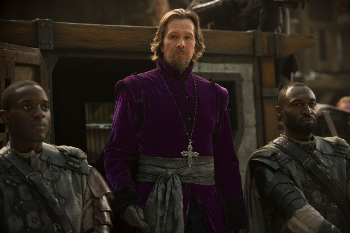 """RRH-03806 GARY OLDMAN as Father Solomon (center) in Warner Bros. Pictures' fantasy thriller """"RED RIDING HOOD,"""" a Warner Bros. Pictures release."""