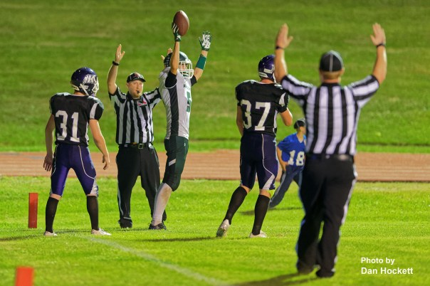 Photo by Dan Hockett West Burlington – Notre Dame Tight End Tate Snodgrass (with ball) signals touchdown after catching a 12-yard pass from Drake Day Friday night in Keokuk. Keokuk defeated WBND, 24-21.