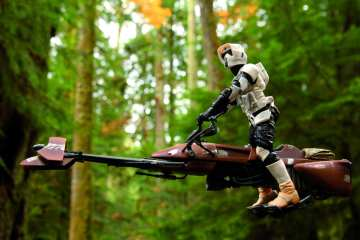Port Alberni, Canada - November 5, 2014: A Scout Trooper from the Star Wars film franchise in the deep forest of Cathedral Grove, near the heart of Vancouver Island. The toy is part of the Black Series, from Hasbro.
