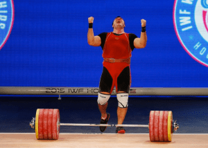 Aleksei Lovchev of Russia celebrates after setting a world record at the 2015 IWF World Championships in Houston, TX.