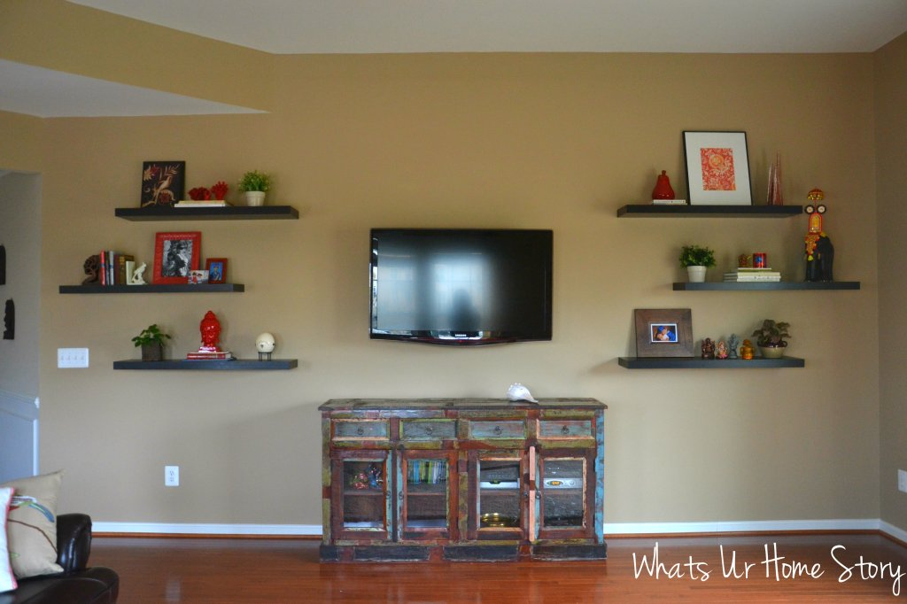 How to decorate around a TV with floating shelves. Check out the Reclaimed wood buffet turned into a media console