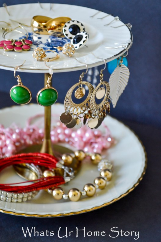 diy jewelry stand with vintage plates and brass candle stick