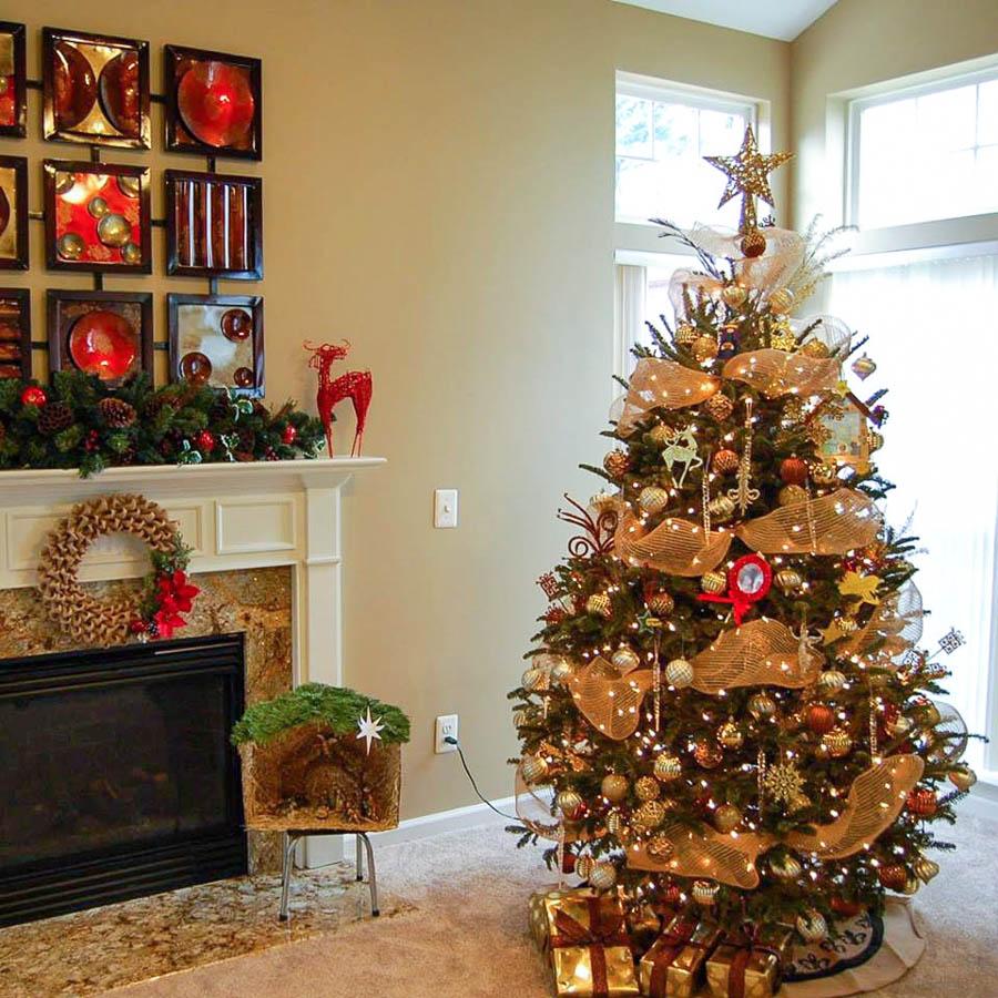 Gold themed Christmas tree and holiday mantel