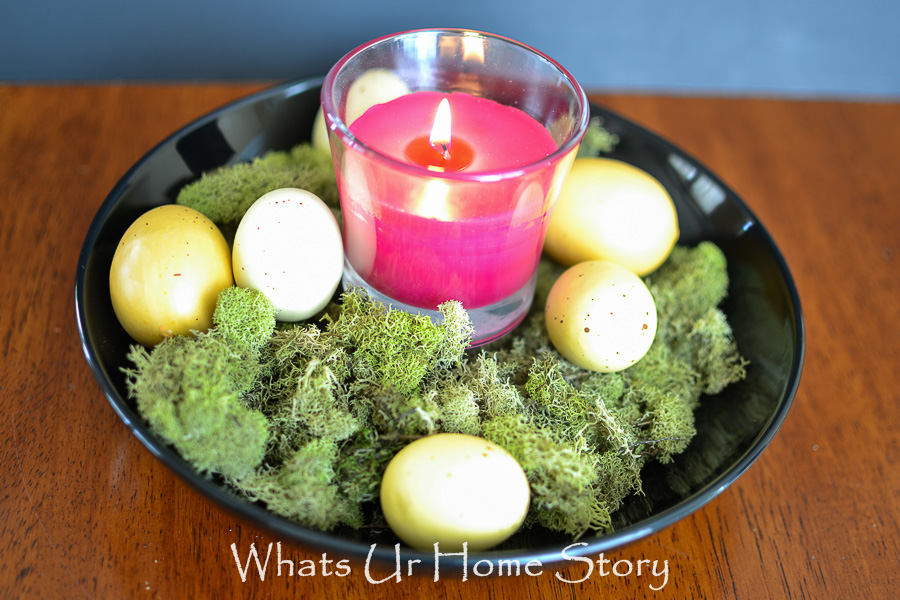 Make this quick and simple Spring centerpiece with a bowl, candle, moss, and Easter Eggs