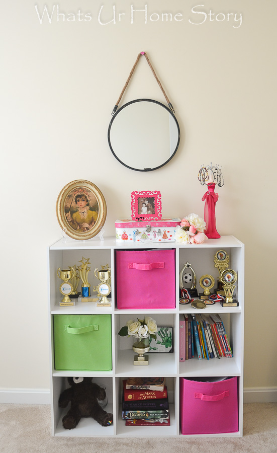 eclectic girls room -storage cubbies and sailor mirror
