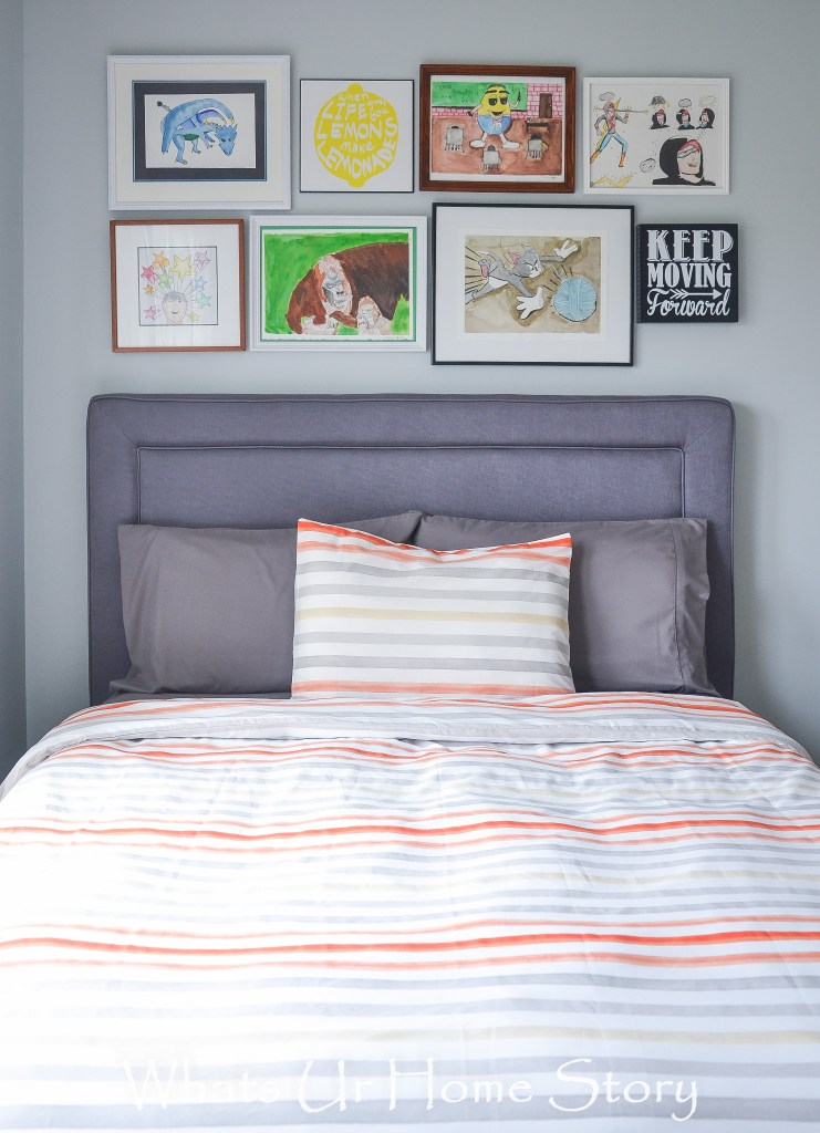 Great idea of hanging the kids' artwork as a gallery wall above the bed! -Gray, blue, and Organge color Boy's room -