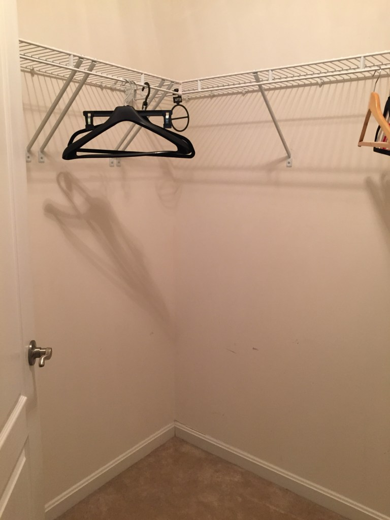 her-master-closet-makeover-small-walk-in-closet