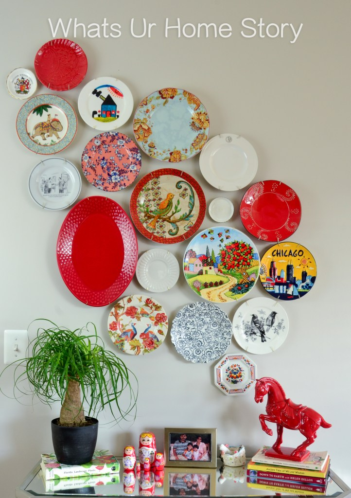 Mismatched-plates-from-the-thrift-store-and-clearance-aisle-come-together-to-create-this-beautiful-asymmetrical-plate-wall.