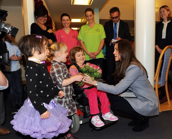 Kate receives a bouquet of posies from Zoe, Zofia and Demi - via @SSChospice on Twitter