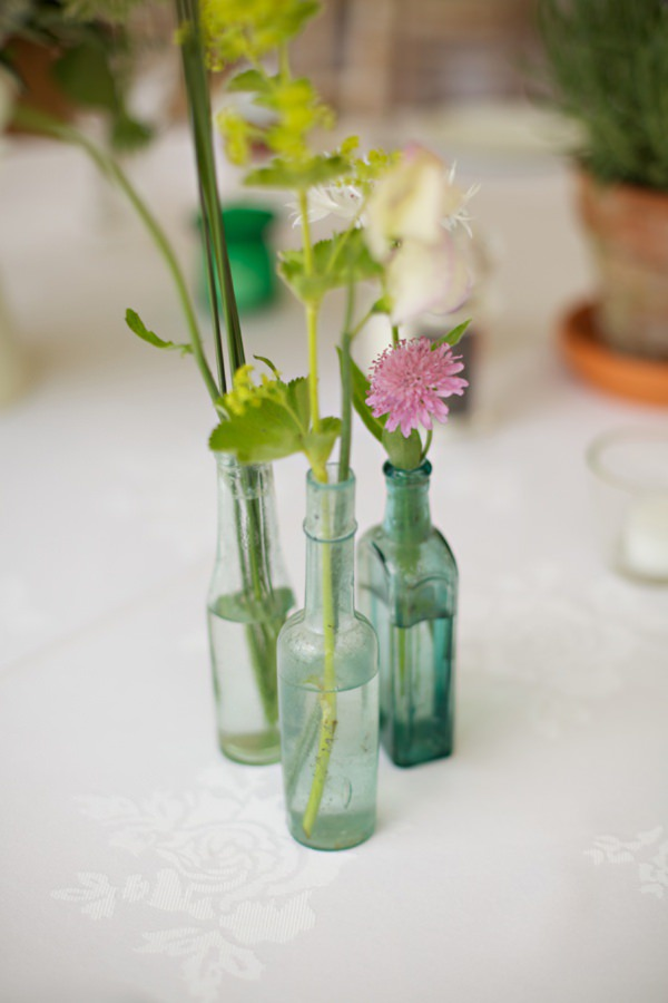 wedding flowers bottles http://www.milkbottlephotography.co.uk/