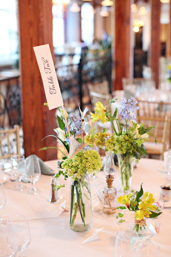 flowers bottles Glamorous Mill Wedding North Carolina http://whiteboxphoto.com/