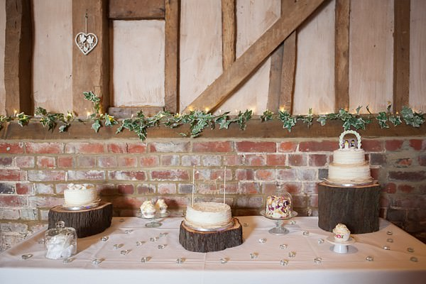 rustic log cake table DIY Lillibrooke Manor Wedding http://fionasweddingphotography.co.uk/